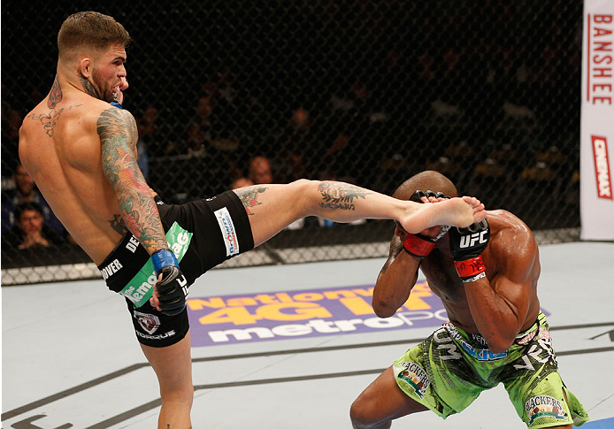 (L-R) Cody Garbrandt kickss Marcus Brimage in their bantamweight bout during the UFC 182 event at the MGM Grand Garden Arena on January 3, 2015 in Las Vegas, NV. (Photo by Josh Hedges/Zuffa LLC)