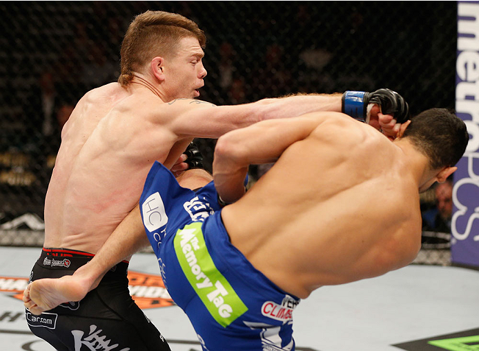 (L-R) Paul Felder punches with Danny Castillo in their lightweight bout during the UFC 182 event at the MGM Grand Garden Arena on January 3, 2015 in Las Vegas, NV. (Photo by Josh Hedges/Zuffa LLC)