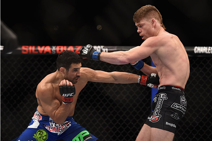 LAS VEGAS, NV - JANUARY 03:  (L) Danny Castillo punches Paul Felder in their lightweight bout during the UFC 182 event at the MGM Grand Garden Arena on January 3, 2015 in Las Vegas, Nevada.  (Photo by Jeff Bottari/Zuffa LLC/Zuffa LLC via Getty Images)