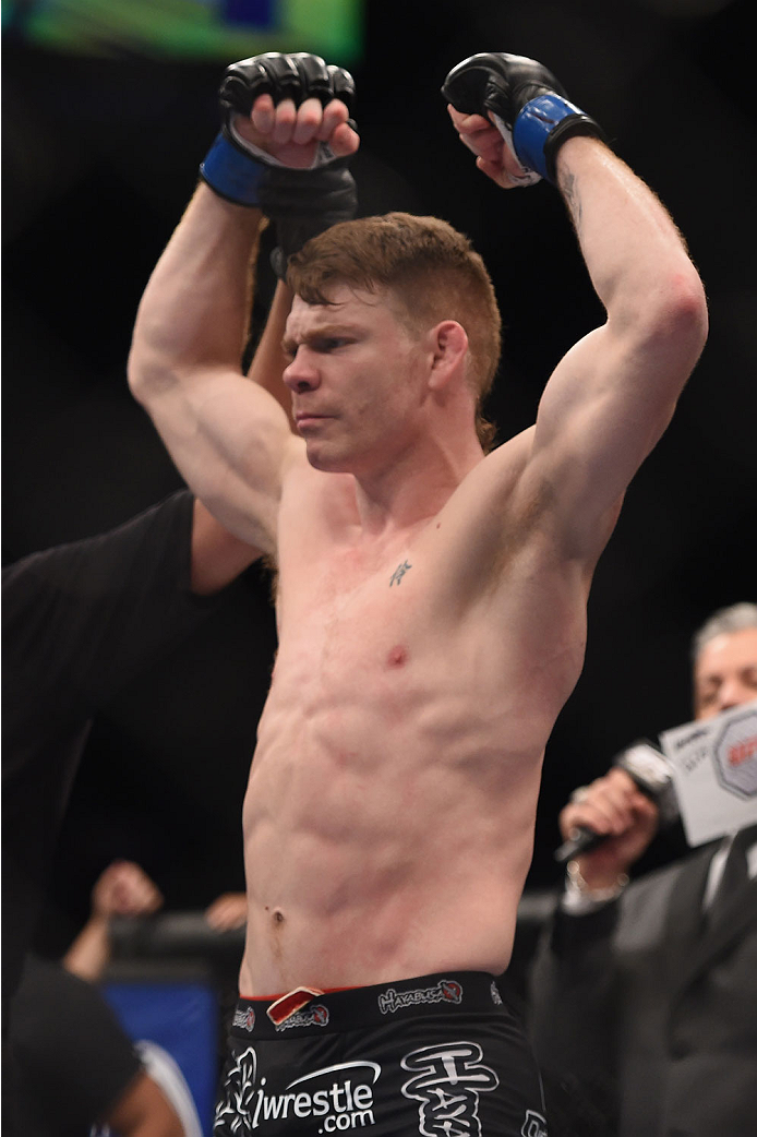 LAS VEGAS, NV - JANUARY 03: Paul Felder celebrates his win over <a href='../fighter/Danny-Castillo'>Danny Castillo</a> in their lightweight bout during the UFC 182 event at the MGM Grand Garden Arena on January 3, 2015 in Las Vegas, Nevada. (Photo by Jeff Bottari/Zuffa LLC)
