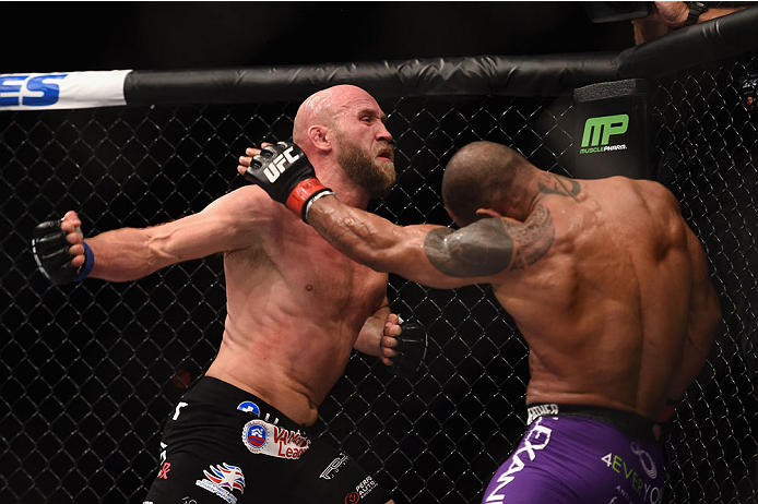 LAS VEGAS, NV - JANUARY 03:  (L) Josh Burkman punches Hector Lombard in their welterweight bout during the UFC 182 event on at the MGM Grand Garden Arena January 3, 2015 in Las Vegas, Nevada.  (Photo by Jeff Bottari/Zuffa LLC/Zuffa LLC via Getty Images)