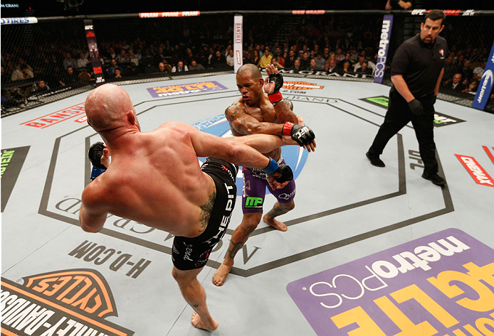 LAS VEGAS, NV - JANUARY 03:  (L-R) Josh Burkman kicks Hector Lombard in their welterweight bout during the UFC 182 event on at the MGM Grand Garden Arena January 3, 2015 in Las Vegas, Nevada.  (Photo by Josh Hedges/Zuffa LLC/Zuffa LLC via Getty Images)