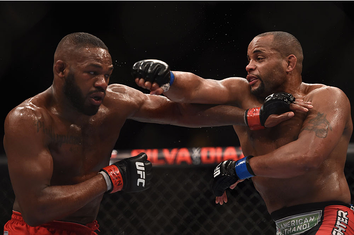 Daniel Cormier punches Jon Jones during their light heavyweighy championship bout during UFC 182 in Las Vegas, NV on 1/3/15. (Photo by Josh Hedges/Zuffa LLC)