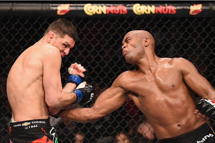 Silva lands a body shot against Diaz