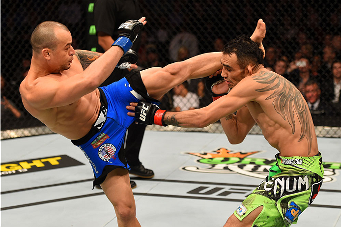 LOS ANGELES, CA - FEBRUARY 28:  (L) Gleison Tibau kicks Tony Ferguson in their lightweight bout during the UFC 184 event at Staples Center on February 28, 2015 in Los Angeles, California.  (Photo by Josh Hedges/Zuffa LLC/Zuffa LLC via Getty Images)