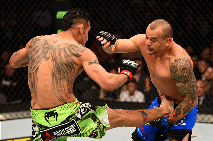LOS ANGELES, CA - FEBRUARY 28:  (L) Tony Ferguson kicks Gleison Tibau in their lightweight bout during the UFC 184 event at Staples Center on February 28, 2015 in Los Angeles, California.  (Photo by Josh Hedges/Zuffa LLC/Zuffa LLC via Getty Images)