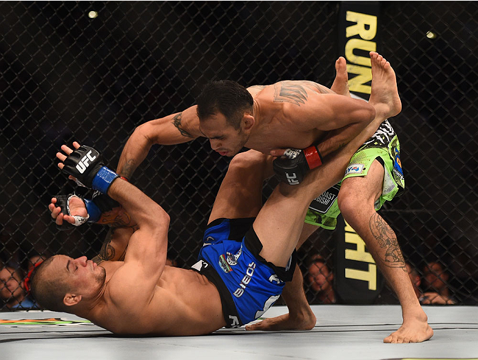 (Top) Tony Ferguson punches Gleison Tibau in their lightweight bout during the UFC 184 event at Staples Center on February 28, 2015 in Los Angeles, California. (Photo by Josh Hedges/Zuffa LLC)