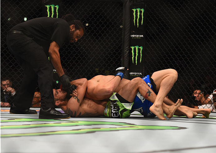 LOS ANGELES, CA - FEBRUARY 28:  (Bottom) Tony Ferguson submits Gleison Tibau in their lightweight bout during the UFC 184 event at Staples Center on February 28, 2015 in Los Angeles, California.  (Photo by Jeff Bottari/Zuffa LLC/Zuffa LLC via Getty Images)
