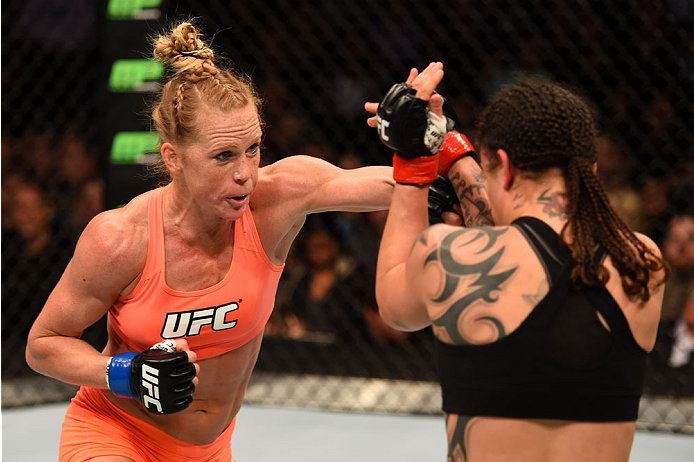 Holly Holm punches Raquel Pennington in their women's bantamweight bout during the UFC 184 event at Staples Center on February 28, 2015 in Los Angeles, CA. (Photo by Josh Hedges/Zuffa LLC)