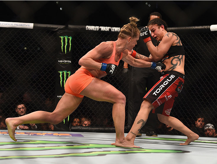 Holm punches Raquel Pennington in their women's bantamweight bout during the UFC 184 event February 28, 2015 in Los Angeles, CA. (Photo by Jeff Bottari/Zuffa LLC)