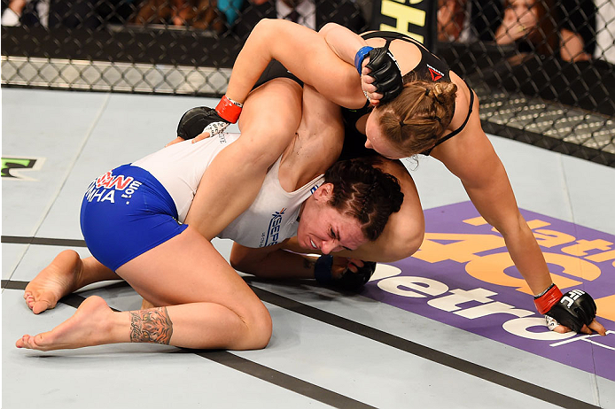 Ronda Rousey works an armbar in the first round