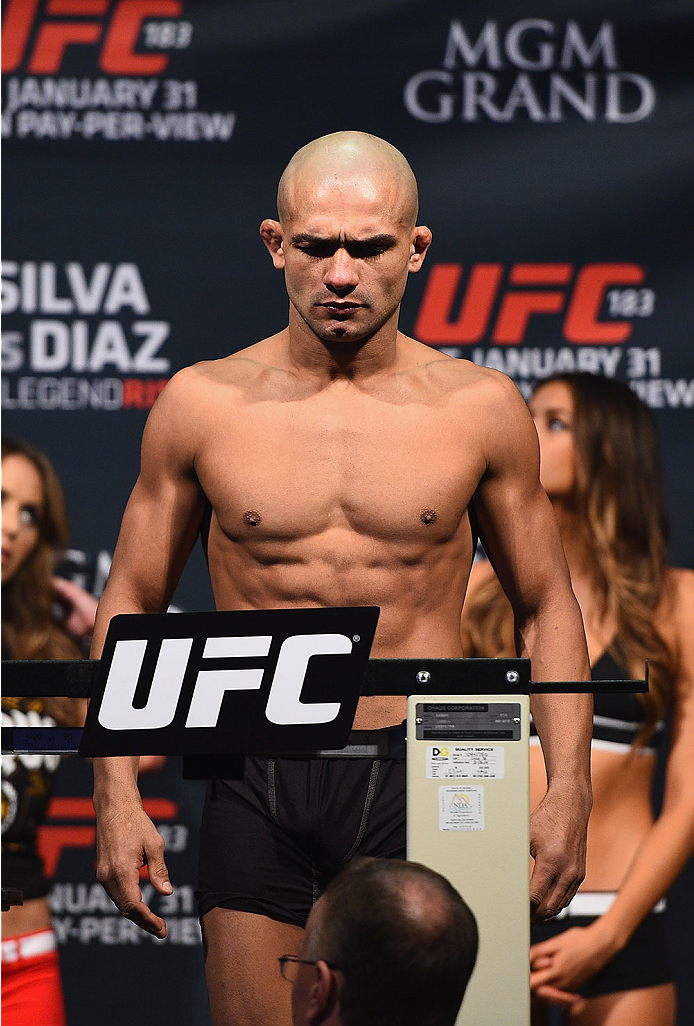 LAS VEGAS, NV - JANUARY 30:  Diego Brandao steps on the scale during the UFC 183 weigh-in at the MGM Grand Garden Arena on January 30, 2015 in Las Vegas, Nevada.  (Photo by Josh Hedges/Zuffa LLC/Zuffa LLC via Getty Images)