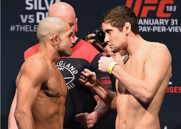 LAS VEGAS, NV - JANUARY 30:  (L-R) Diego Brandao and Jimmy Hettes face off during the UFC 183 weigh-in at the MGM Grand Garden Arena on January 30, 2015 in Las Vegas, Nevada.  (Photo by Josh Hedges/Zuffa LLC/Zuffa LLC via Getty Images)