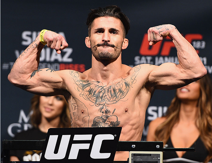 <a href='../fighter/Ian-McCall'>Ian McCall</a> weighs in before his fight with <a href='../fighter/John-Lineker'>John Lineker</a> at UFC 183