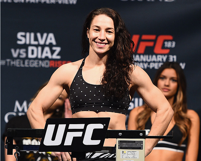 LAS VEGAS, NV - JANUARY 30:  Sara McMann steps on the scale during the UFC 183 weigh-in at the MGM Grand Garden Arena on January 30, 2015 in Las Vegas, Nevada.  (Photo by Josh Hedges/Zuffa LLC/Zuffa LLC via Getty Images)