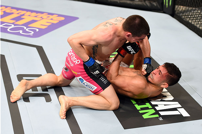 Ryan Benoit lands a punch against Sergio Pettis at UFC 185