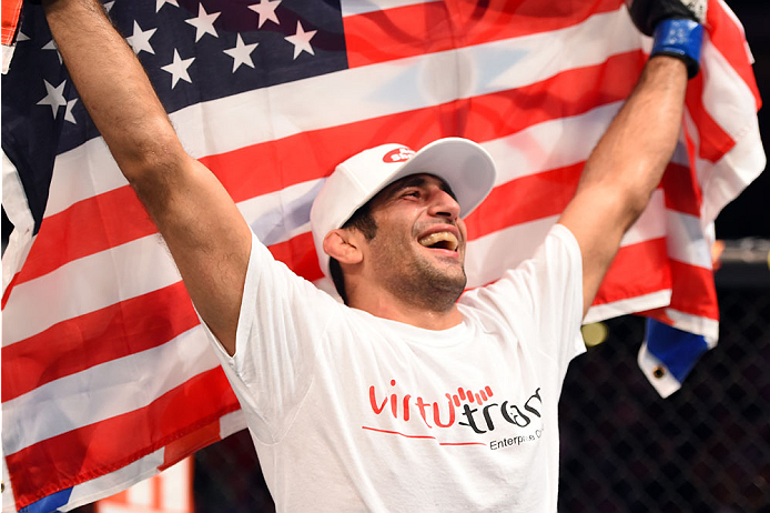 Beneil Dariush celebrates after defeating Daron Cruickshank in their lightweight bout during the UFC 185 event at the American Airlines Center on March 14, 2015 in Dallas, Texas. (Photo by Josh Hedges/Zuffa LLC)
