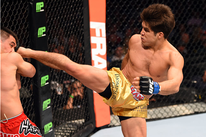 DALLAS, TX - MARCH 14:  (R-L) Henry Cejudo kicks the head of Chris Cariaso in their flyweight bout during the UFC 185 event at the American Airlines Center on March 14, 2015 in Dallas, Texas. (Photo by Josh Hedges/Zuffa LLC/Zuffa LLC via Getty Images)