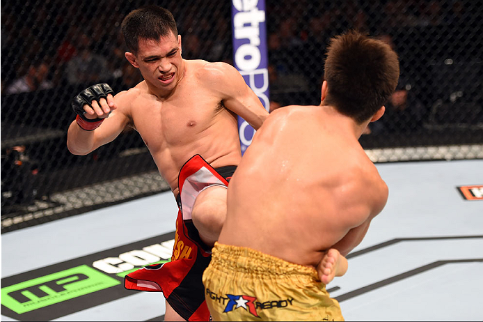 DALLAS, TX - MARCH 14:  (L-R) Chris Cariaso lands a kick to the body of Henry Cejudo in their flyweight bout during the UFC 185 event at the American Airlines Center on March 14, 2015 in Dallas, Texas. (Photo by Josh Hedges/Zuffa LLC/Zuffa LLC via Getty Images)
