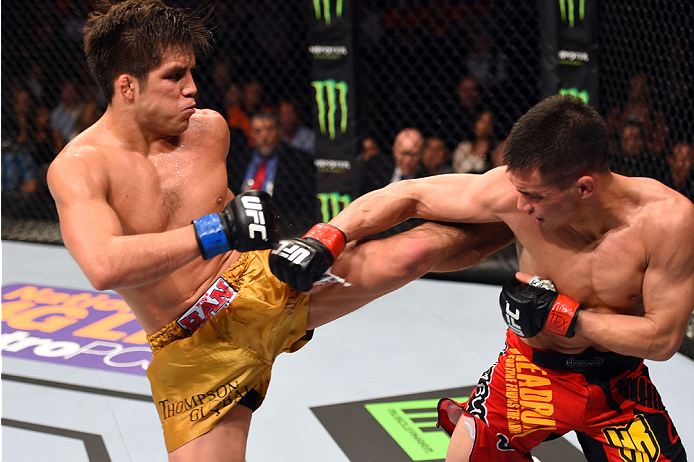 DALLAS, TX - MARCH 14:  (L-R) Henry Cejudo kicks Chris Cariaso in their flyweight bout during the UFC 185 event at the American Airlines Center on March 14, 2015 in Dallas, Texas. (Photo by Josh Hedges/Zuffa LLC/Zuffa LLC via Getty Images)