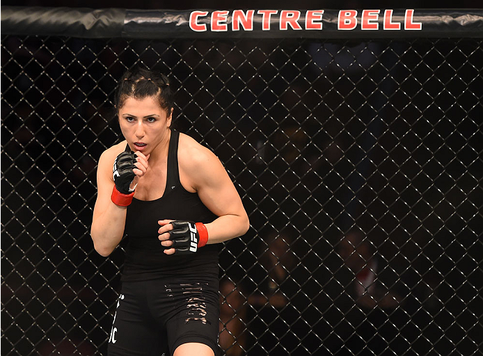 MONTREAL, QC - APRIL 25:   Randa Markos of Canada stands in the Octagon before her women's strawweight bout against Aisling Daly of Ireland during the UFC 186 event at the Bell Centre on April 25, 2015 in Montreal, Quebec, Canada. (Photo by Josh Hedges/Zuffa LLC/Zuffa LLC via Getty Images)