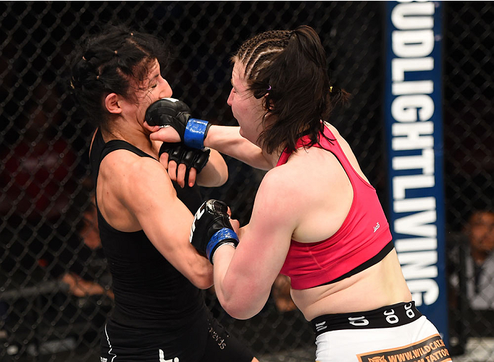 MONTREAL, QC - APRIL 25:   (R-L) Aisling Daly of Ireland punches Randa Markos of Canada in their women's strawweight bout during the UFC 186 event at the Bell Centre on April 25, 2015 in Montreal, Quebec, Canada. (Photo by Josh Hedges/Zuffa LLC/Zuffa LLC via Getty Images)