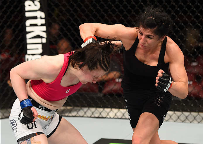 MONTREAL, QC - APRIL 25:   (R-L) Randa Markos of Canada punches Aisling Daly of Ireland in their women's strawweight bout during the UFC 186 event at the Bell Centre on April 25, 2015 in Montreal, Quebec, Canada. (Photo by Josh Hedges/Zuffa LLC/Zuffa LLC via Getty Images)