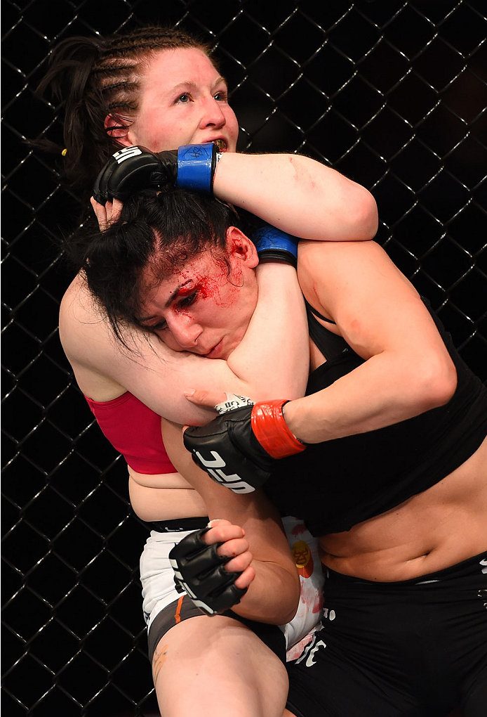 MONTREAL, QC - APRIL 25:   (L-R) Aisling Daly of Ireland attempts to secure a rear choke against Randa Markos of Canada in their women's strawweight bout during the UFC 186 event at the Bell Centre on April 25, 2015 in Montreal, Quebec, Canada. (Photo by Josh Hedges/Zuffa LLC/Zuffa LLC via Getty Images)