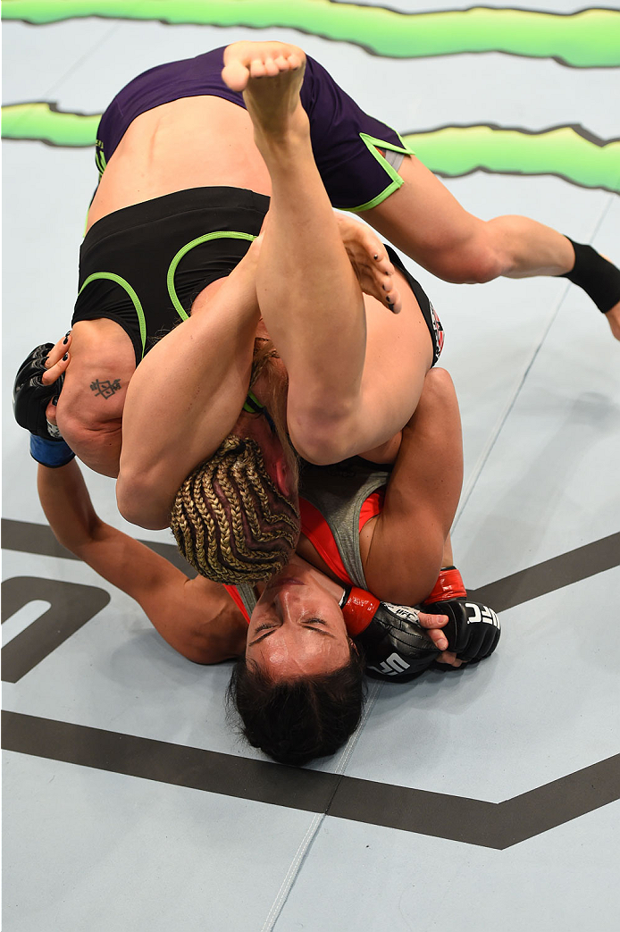MONTREAL, QC - APRIL 25:   Valerie Letourneau (bottom) of Canada attempts to secure a triangle choke submission against Jessica Rakoczy in their women's strawweight bout during the UFC 186 event at the Bell Centre on April 25, 2015 in Montreal, Quebec, Canada. (Photo by Josh Hedges/Zuffa LLC/Zuffa LLC via Getty Images)