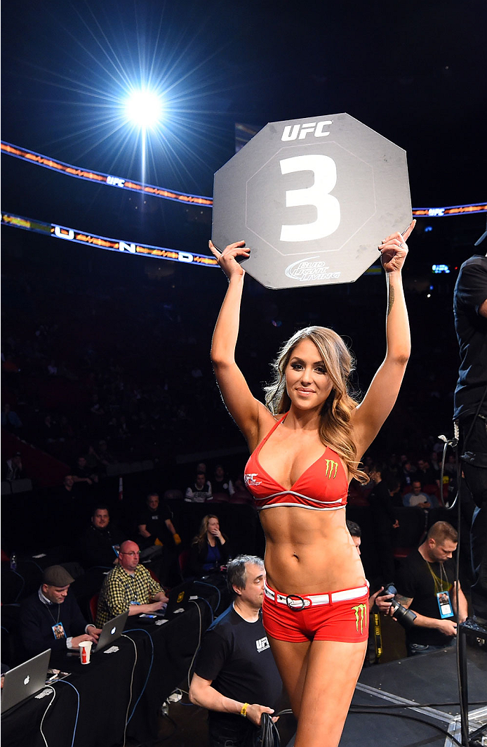 MONTREAL, QC - APRIL 25:   UFC Octagon Girl Brittney Palmer introduces a round during the UFC 186 event at the Bell Centre on April 25, 2015 in Montreal, Quebec, Canada. (Photo by Josh Hedges/Zuffa LLC/Zuffa LLC via Getty Images)