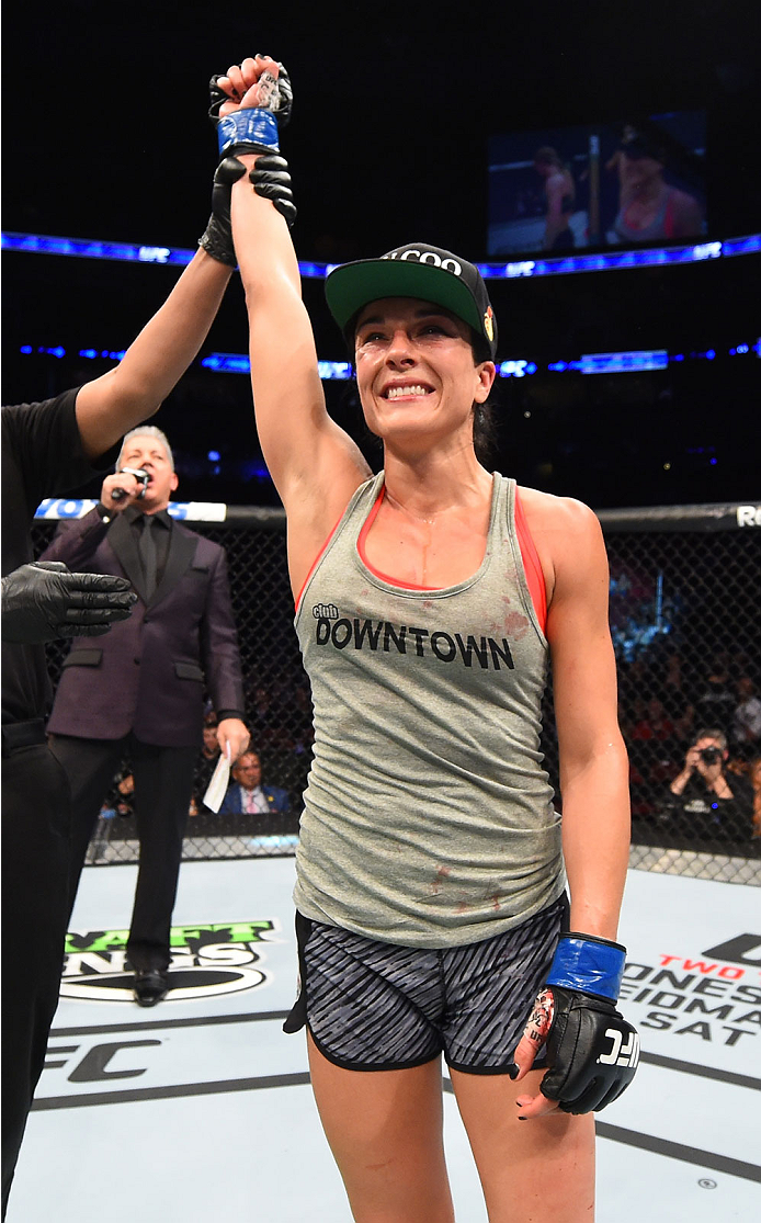 MONTREAL, QC - APRIL 25:   Valerie Letourneau of Canada celebrates after her decision victory over Jessica Rakoczy in their women's strawweight bout during the UFC 186 event at the Bell Centre on April 25, 2015 in Montreal, Quebec, Canada. (Photo by Josh Hedges/Zuffa LLC/Zuffa LLC via Getty Images)