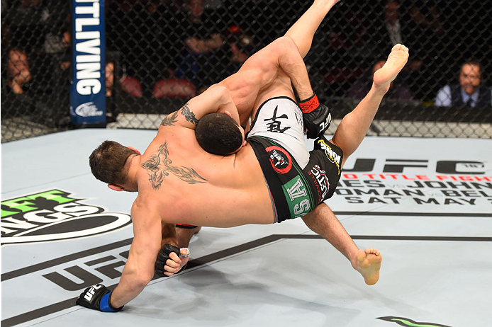 MONTREAL, QC - APRIL 25:   (L-R) Nordine Taleb of Canada takes down Chris Clements of Canada in their welterweight bout during the UFC 186 event at the Bell Centre on April 25, 2015 in Montreal, Quebec, Canada. (Photo by Josh Hedges/Zuffa LLC/Zuffa LLC via Getty Images)
