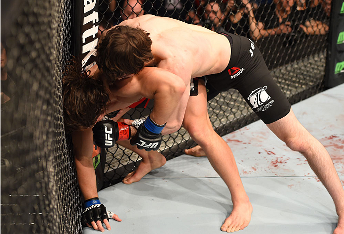 MONTREAL, QC - APRIL 25:   (R-L) Olivier Aubin-Mercier of Canada punches David Michaud of the United States in their lightweight bout during the UFC 186 event at the Bell Centre on April 25, 2015 in Montreal, Quebec, Canada. (Photo by Josh Hedges/Zuffa LLC/Zuffa LLC via Getty Images)
