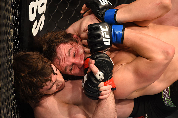 MONTREAL, QC - APRIL 25:   (L-R) Olivier Aubin-Mercier of Canada attempts to secure a rear choke against David Michaud of the United States in their lightweight bout during the UFC 186 event at the Bell Centre on April 25, 2015 in Montreal, Quebec, Canada. (Photo by Josh Hedges/Zuffa LLC/Zuffa LLC via Getty Images)