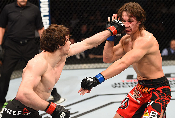 MONTREAL, QC - APRIL 25:   (L-R) Olivier Aubin-Mercier of Canada punches David Michaud of the United States in their lightweight bout during the UFC 186 event at the Bell Centre on April 25, 2015 in Montreal, Quebec, Canada. (Photo by Josh Hedges/Zuffa LLC/Zuffa LLC via Getty Images)