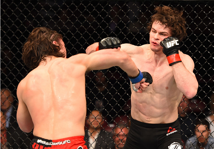 MONTREAL, QC - APRIL 25:   (L-R) David Michaud of the United States punches Olivier Aubin-Mercier of Canada in their lightweight bout during the UFC 186 event at the Bell Centre on April 25, 2015 in Montreal, Quebec, Canada. (Photo by Josh Hedges/Zuffa LLC/Zuffa LLC via Getty Images)