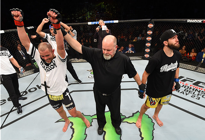 MONTREAL, QC - APRIL 25:   Chad Laprise (L) of Canada reacts after his decision victory over Bryan Barberena of the United States in their lightweight bout during the UFC 186 event at the Bell Centre on April 25, 2015 in Montreal, Quebec, Canada. (Photo by Josh Hedges/Zuffa LLC/Zuffa LLC via Getty Images)