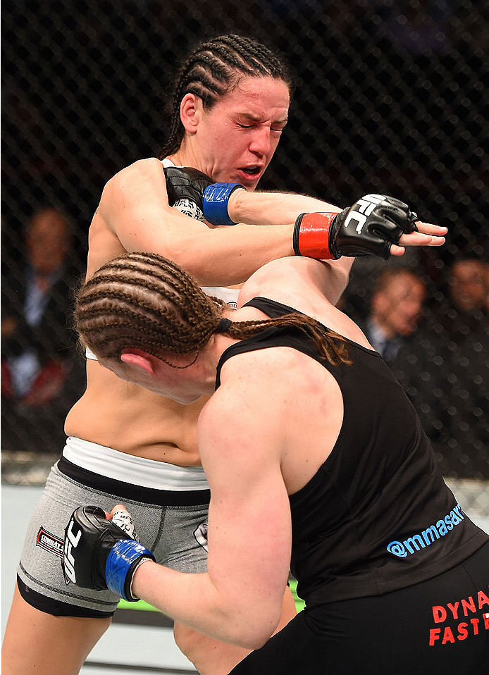 MONTREAL, QC - APRIL 25:   (R-L) Sarah Kaufman of Canada punches Alexis Davis of Canada in their women's bantamweight bout during the UFC 186 event at the Bell Centre on April 25, 2015 in Montreal, Quebec, Canada. (Photo by Josh Hedges/Zuffa LLC/Zuffa LLC via Getty Images)
