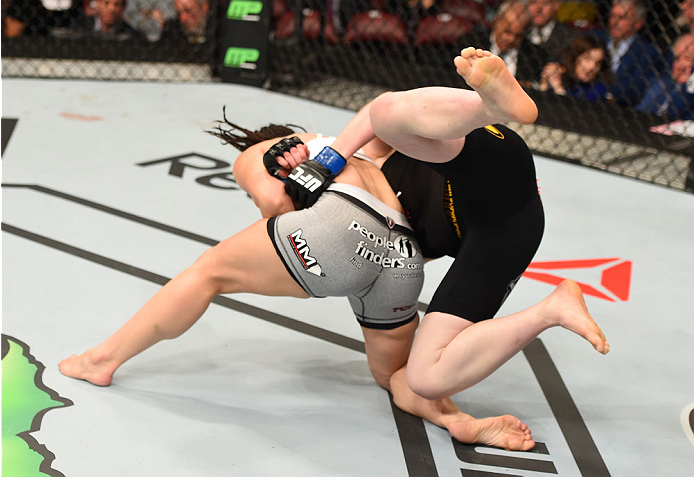 MONTREAL, QC - APRIL 25:   (L-R) Alexis Davis of Canada throws Sarah Kaufman of Canada to the mat in their women's bantamweight bout during the UFC 186 event at the Bell Centre on April 25, 2015 in Montreal, Quebec, Canada. (Photo by Josh Hedges/Zuffa LLC/Zuffa LLC via Getty Images)