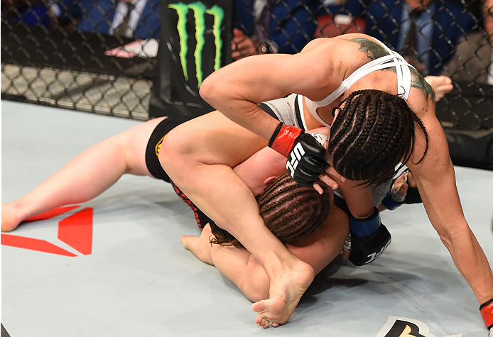 MONTREAL, QC - APRIL 25:   (R-L) Alexis Davis of Canada attempts to secure a mounted triangle choke against Sarah Kaufman of Canada in their women's bantamweight bout during the UFC 186 event at the Bell Centre on April 25, 2015 in Montreal, Quebec, Canada. (Photo by Josh Hedges/Zuffa LLC/Zuffa LLC via Getty Images)