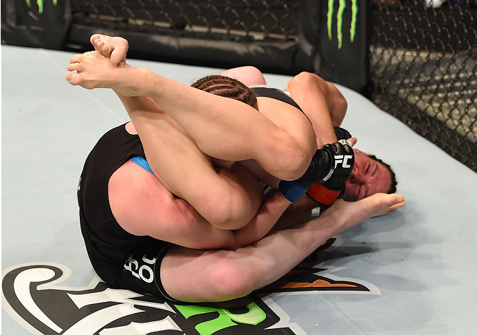 MONTREAL, QC - APRIL 25:   (R-L) Alexis Davis of Canada secures an arm bar submission against Sarah Kaufman of Canada in their women's bantamweight bout during the UFC 186 event at the Bell Centre on April 25, 2015 in Montreal, Quebec, Canada. (Photo by Josh Hedges/Zuffa LLC/Zuffa LLC via Getty Images)