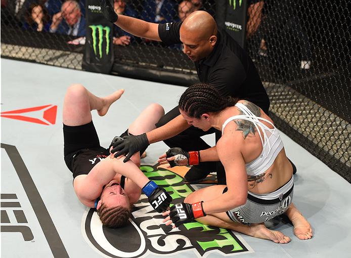MONTREAL, QC - APRIL 25:   (R-L) Alexis Davis of Canada checks on opponent Sarah Kaufman of Canada after her submission victory in their women's bantamweight bout during the UFC 186 event at the Bell Centre on April 25, 2015 in Montreal, Quebec, Canada. (Photo by Josh Hedges/Zuffa LLC/Zuffa LLC via Getty Images)