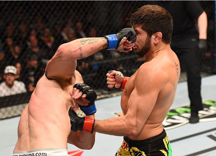 MONTREAL, QC - APRIL 25:   (R-L) Patrick Cote of Canada and Joe Riggs of the United Sates trade punches in their welterweight bout during the UFC 186 event at the Bell Centre on April 25, 2015 in Montreal, Quebec, Canada. (Photo by Josh Hedges/Zuffa LLC/Zuffa LLC via Getty Images)