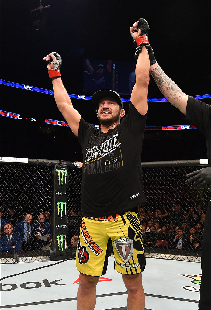 MONTREAL, QC - APRIL 25:   Patrick Cote of Canada reacts after his decision victory over Joe Riggs of the United Sates in their welterweight bout during the UFC 186 event at the Bell Centre on April 25, 2015 in Montreal, Quebec, Canada. (Photo by Josh Hedges/Zuffa LLC/Zuffa LLC via Getty Images)
