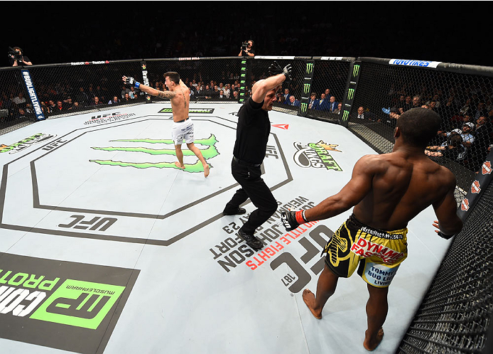 MONTREAL, QC - APRIL 25:   Thomas Almeida (L) of Brazil reacts after his TKO victory over Yves Jabouin of Canada in their bantamweight bout during the UFC 186 event at the Bell Centre on April 25, 2015 in Montreal, Quebec, Canada. (Photo by Josh Hedges/Zuffa LLC/Zuffa LLC via Getty Images)