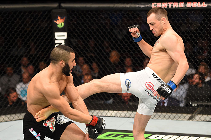 MONTREAL, QC - APRIL 25:   (R-L) Shane Campbell of the United States kicks John Makdessi of Canada in their catchweight bout during the UFC 186 event at the Bell Centre on April 25, 2015 in Montreal, Quebec, Canada. (Photo by Josh Hedges/Zuffa LLC/Zuffa LLC via Getty Images)