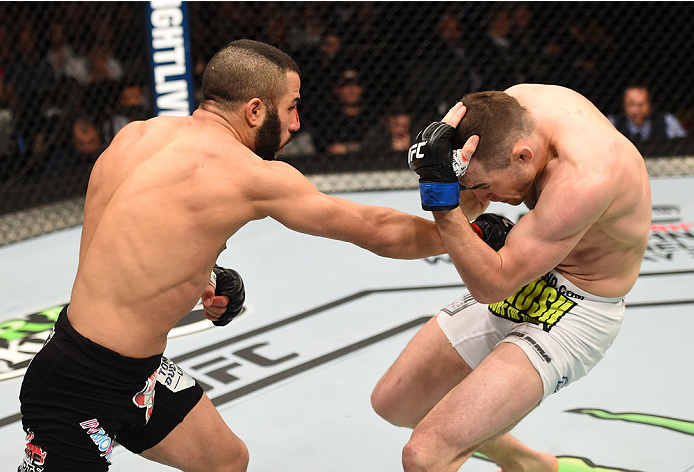 MONTREAL, QC - APRIL 25:   (L-R) John Makdessi of Canada punches Shane Campbell of the United States in their catchweight bout during the UFC 186 event at the Bell Centre on April 25, 2015 in Montreal, Quebec, Canada. (Photo by Josh Hedges/Zuffa LLC/Zuffa LLC via Getty Images)