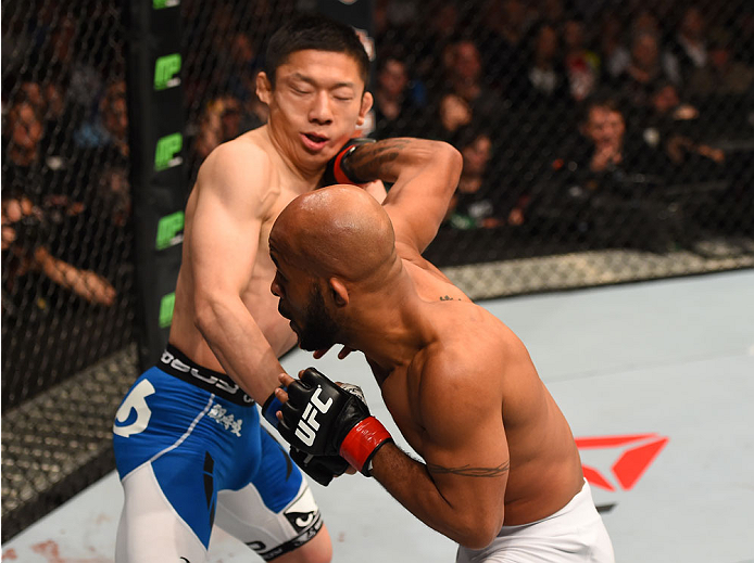 MONTREAL, QC - APRIL 25:   (R-L) Demetrious Johnson of the United States punches Kyoji Horiguchi of Japan in their UFC flyweight championship bout during the UFC 186 event at the Bell Centre on April 25, 2015 in Montreal, Quebec, Canada. (Photo by Josh Hedges/Zuffa LLC/Zuffa LLC via Getty Images)
