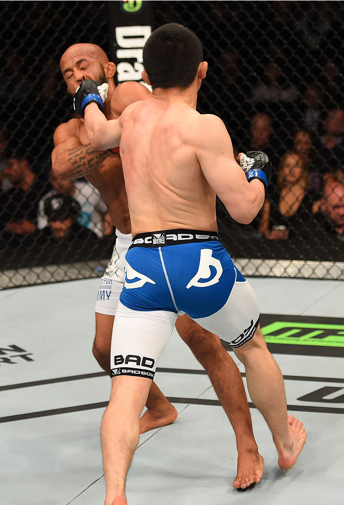 MONTREAL, QC - APRIL 25:   (R-L) Kyoji Horiguchi of Japan punches Demetrious Johnson of the United States in their UFC flyweight championship bout during the UFC 186 event at the Bell Centre on April 25, 2015 in Montreal, Quebec, Canada. (Photo by Josh Hedges/Zuffa LLC/Zuffa LLC via Getty Images)