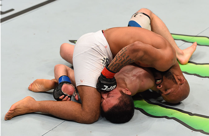 MONTREAL, QC - APRIL 25:   Demetrious Johnson (top) punches Kyoji Horiguchi in their UFC flyweight championship bout during the UFC 186 event at the Bell Centre on April 25, 2015 in Montreal, Quebec, Canada. (Photo by Josh Hedges/Zuffa LLC/Zuffa LLC via Getty Images)